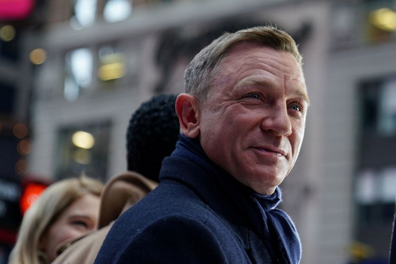 FILE PHOTO: Actor Daniel Craig reacts during a promotional appearance on TV in Times Square for the new James Bond movie