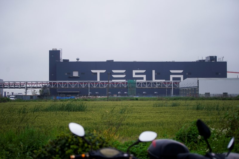 A Tesla sign is seen at its factory in Shanghai