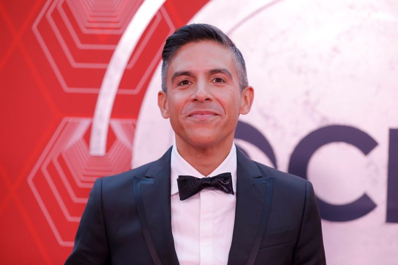 Matthew Lopez poses on the red carpet as he arrives for the 74th Annual Tony Awards in New York