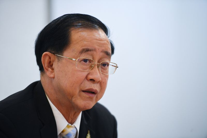 FILE PHOTO: Thai finance minister Arkhom Termpittayapaisith speaks during an interview with Reuters in Bangkok, Thailand