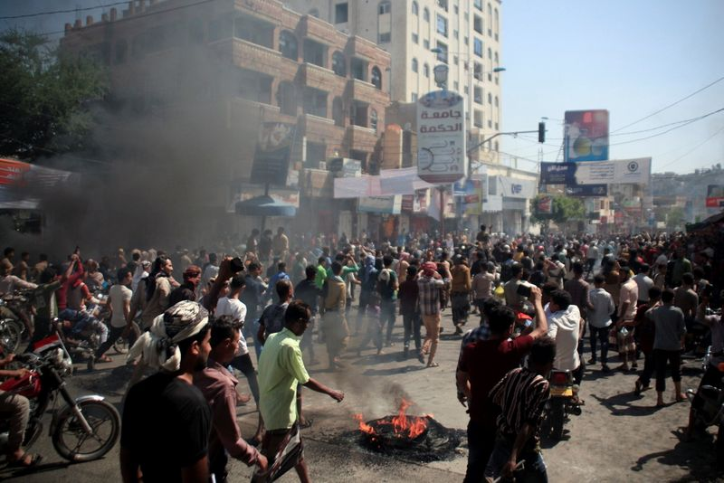 People demonstrate against the deteriorating economic situation and the devaluation of the local currency, in Taiz