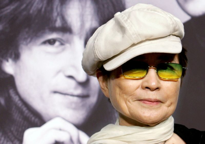 FILE PHOTO: John Lennon's wife Yoko Ono listens to reporter's questions in Tokyo
