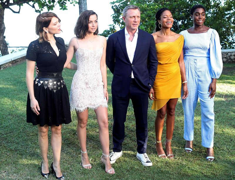 FILE PHOTO: Actors Lea Seydoux, Ana de Armas, Daniel Craig, Naomie Harris and Lashana Lynch pose for a picture during a photocall for the British spy franchise's 25th film set for release next year, titled