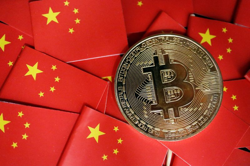 Picture illustration of China's flags and cryptocurrency