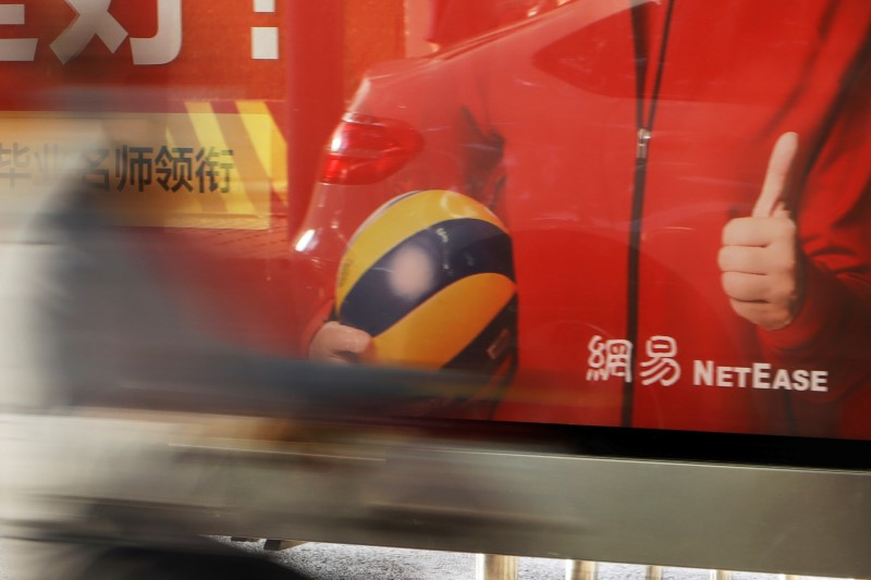 The logo of Chinese technology company NetEase is seen on an advertisement at a bus stop in Beijing