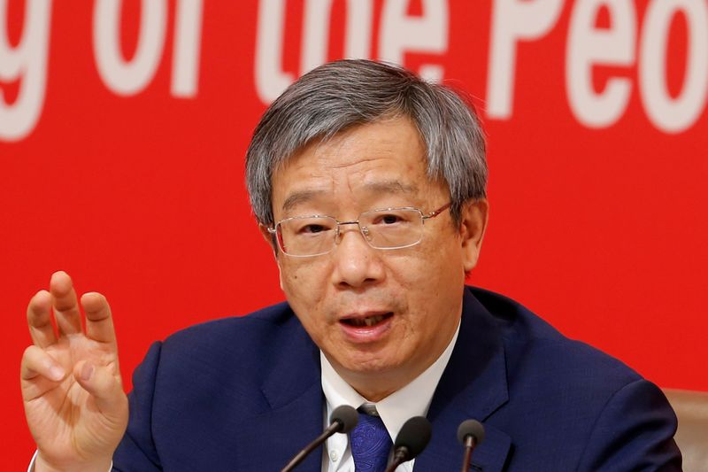 Governor of People's Bank of China (PBOC) Yi Gang attends a news conference on China's economic development ahead of the 70th anniversary of its founding, in Beijing