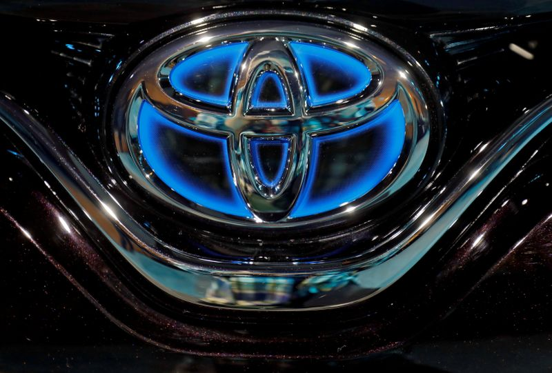 FILE PHOTO: The Toyota logo is seen on the bonnet of a newly launched Camry Hybrid electric vehicle at a hotel in New Delhi