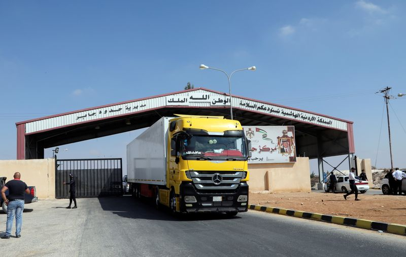 A truck drives at Jaber border crossing with Syria, near Mafraq