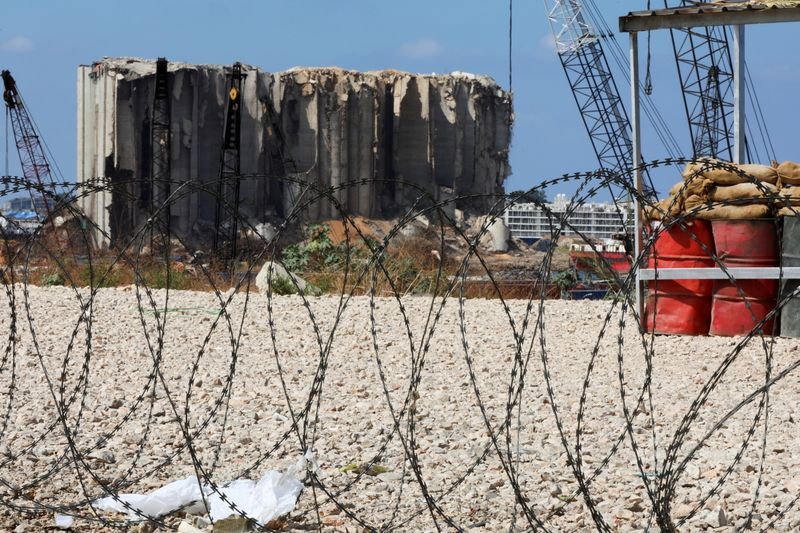 Razor wire in front of the site of the 2020 Beirut port explosion