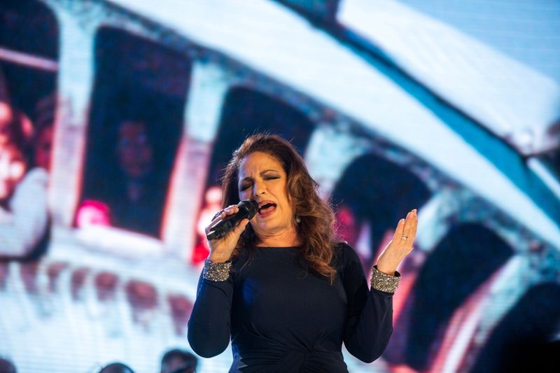FILE PHOTO: Gloria Estefan performs during the opening celebration of the Statue of Liberty Museum on Liberty Island in New York