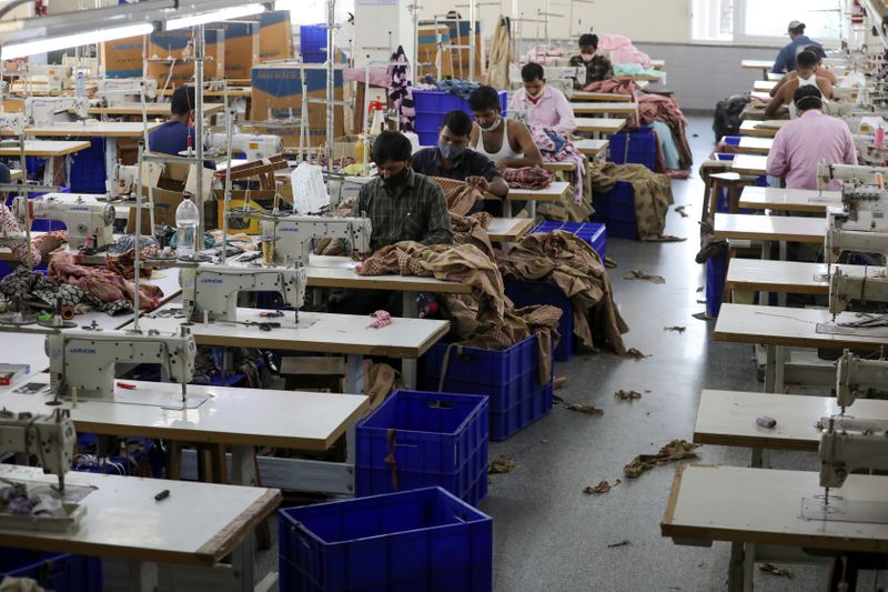 Workers stitch garments at a factory of an apparel shop in Jaipur