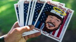 VANCOUVER WASH - SEPTEMBER 5: An organizer displays stickers during a memorial for Patriot Prayer member Aaron Jay Danielson on September 5, 2020 in Vancouver, Washington. Danielson was shot and killed on Saturday, August 29 during a pro-Trump rally in Portland, Oregon. (Photo by Nathan Howard/Getty Images)