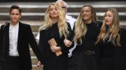 """US actress Amber Heard (C) leaves the High Court with partner Bianca Butti (L) and sister Whitney after the final day of the libel trial by her former husband US actor Johnny Depp against News Group Newspapers (NGN) in London, on July 28, 2020. - Depp is suing the publishers of The Sun and the author of the article for the claims that called him a """"wife-beater"""" in April 2018. (Photo by DANIEL LEAL-OLIVAS / AFP) (Photo by DANIEL LEAL-OLIVAS/AFP via Getty Images)"""