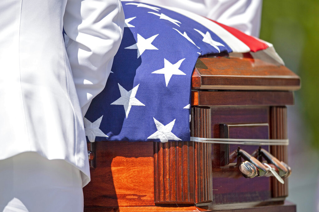 Members of the U.S. Navy Honor Guard guard remove the casket of Navy Corpsman Maxton Soviak at Morman-Hinman-Tanner Funeral Home, Wednesday, Sept. 8, 2021, in Berlin Heights, Ohio. Soviak was one of 13 U.S. troops killed in a horrific suicide bombing at Afghanistan's Kabul airport on Aug. 26. (AP Photo/David Dermer).