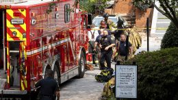 Emergency workers respond following an apartment explosion, Sunday, Sept. 12, 2021, in Dunwoody, Ga., just outside of Atlanta. (AP Photo/Ben Gray)