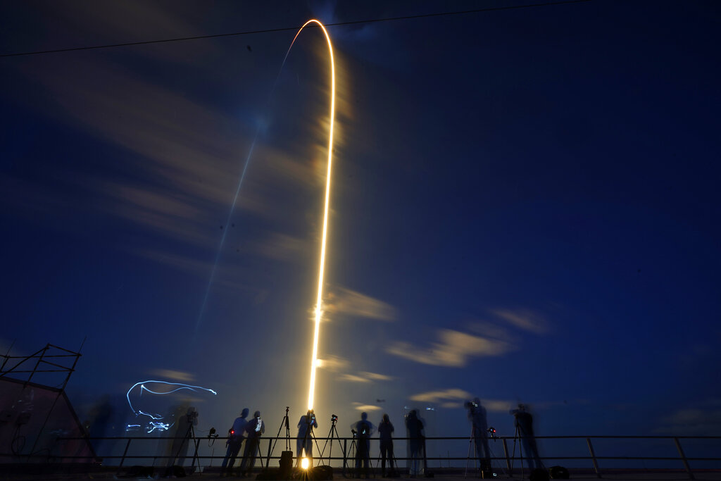 A SpaceX Falcon 9 rocket, with four private citizens onboard, lifts off in this time-exposure photo from Kennedy Space Center's Launch Pad 39-A, Wednesday, Sept. 15, 2021, in Cape Canaveral, Fla. (AP Photo/John Raoux)