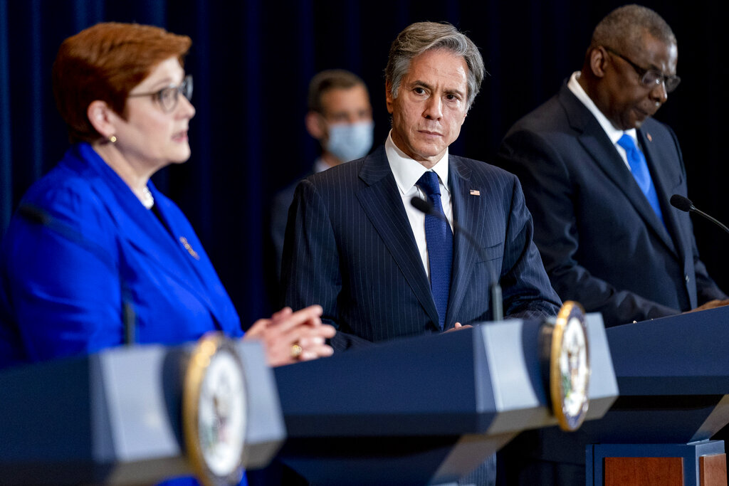 Australian Foreign Minister Marise Payne, left, accompanied by Secretary of State Antony Blinken, second from right, and Defense Secretary Lloyd Austin, right, speaks at a news conference at the State Department in Washington, Thursday, Sept. 16, 2021. (AP Photo/Andrew Harnik, Pool)