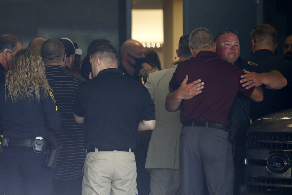 Police officers gather at the hospital where two Houston police officers were sent to after being shot while serving an arrest warrant on Monday, Sept. 20, 2021, at Memorial Hermann Hospital in Houston. Authorities say a Houston police officer was killed and another was wounded during a shooting that also killed a 31-year-old man who the officers were attempting to arrest. (Yi-Chin Lee/Houston Chronicle via AP)