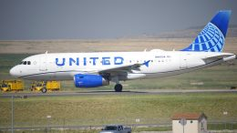 FILE - In this July 2, 2021 file photo, a United Airlines jetliner taxis down a runway for take off from Denver International Airport in Denver. United Airlines has been fined, Friday, Sept. 24, 2021, $1.9 million over 25 delayed flights in which passengers were stuck on the ground for at least three hours. It's the largest fine ever imposed by the U.S. Transportation Department for such long delays.(AP Photo/David Zalubowski, file)