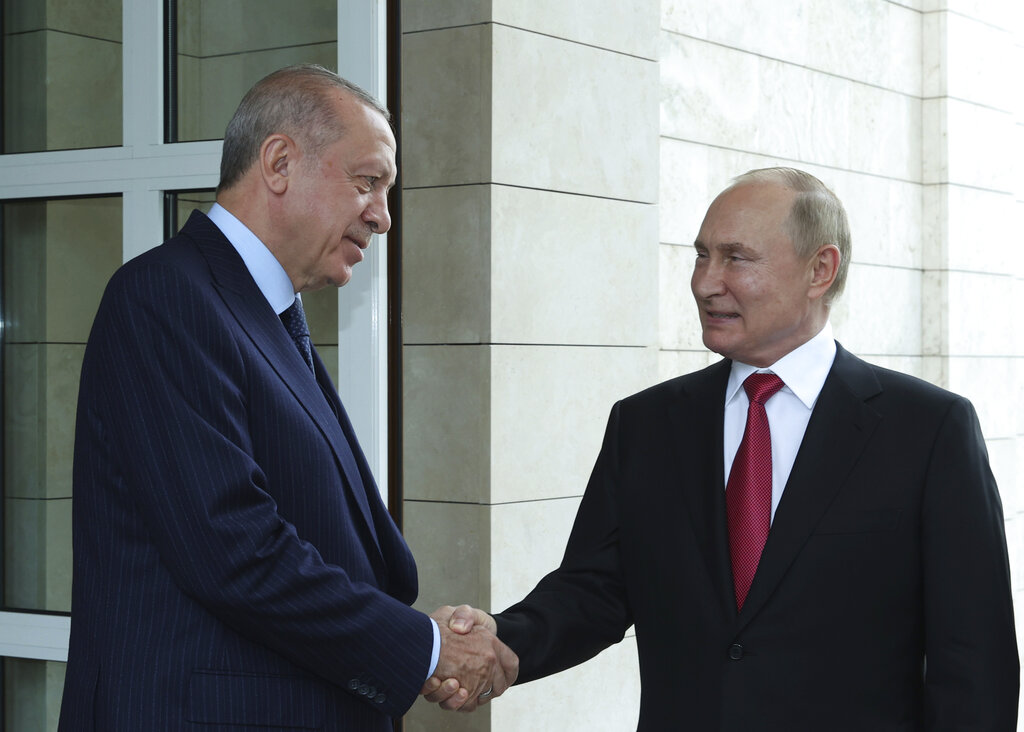 Russian President Vladimir Putin, right, and Turkish President Recep Tayyip Erdogan speak as Erdogan leaves after their talks at the Bocharov Ruchei residence in the Black Sea resort of Sochi, Russia, Wednesday, Sept. 29, 2021. Putin hosted his Turkish counterpart Erdogan for talks in the Black Sea resort of Sochi on Wednesday. It was the first in-person meeting for Putin in over two weeks. On Sept. 14, the Russian president went into self-isolation after a staff member he worked in close contact with contracted coronavirus.(Turkish Presidency Pool Photo via AP)