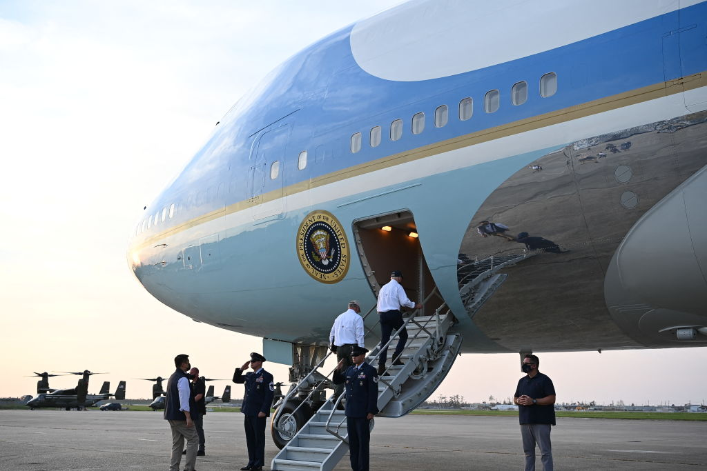 US President Joe Biden makes his way to board Air Force One before departing from Louis Armstrong New Orleans International Airport in Kenner, Louisiana on September 3, 2021. - President Joe Biden, who has made threats from climate change a priority, arrived in New Orleans to tour damage from Hurricane Ida, which pounded the Gulf Coast before bringing havoc to New York. (Photo by MANDEL NGAN / AFP) (Photo by MANDEL NGAN/AFP via Getty Images)