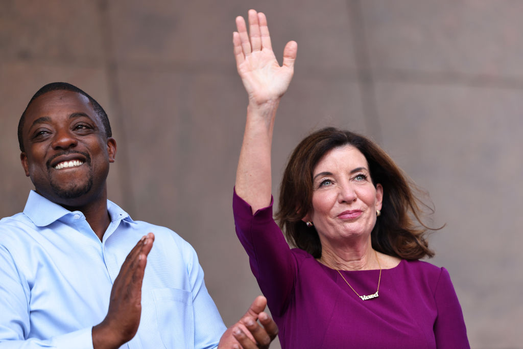 NEW YORK, NEW YORK - AUGUST 26: State Senator Brian Benjamin and Gov. Kathy Hochul celebrate during a press conference announcing State Senator Brian Benjamin as Lt. Governor on August 26, 2021 in New York City. Senator Benjamin, who placed fourth in the Democratic primary for city comptroller earlier this year, will replace Hochul who was sworn in as Governor this week after the resignation of former Gov. Andrew Cuomo. Senator Benjamin has been a lead sponsor and advocate for criminal and police reforms that includes the Eric Garner Anti-Chokehold Act and the Less is More Act, which restricts the use of incarceration for non-criminal technical parole violations. He has also been a proponent of affordable housing. (Photo by Michael M. Santiago/Getty Images)