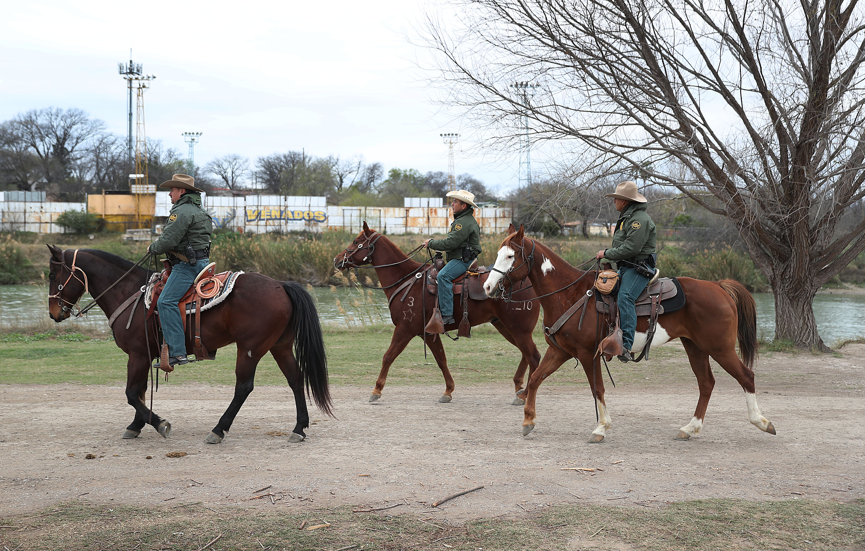 Border Patrol agents use horses to patrol along the banks of the Rio Grande which is the U.S.-Mexico border in Eagle Pass, Texas. (Photo by Joe Raedle/Getty Images)