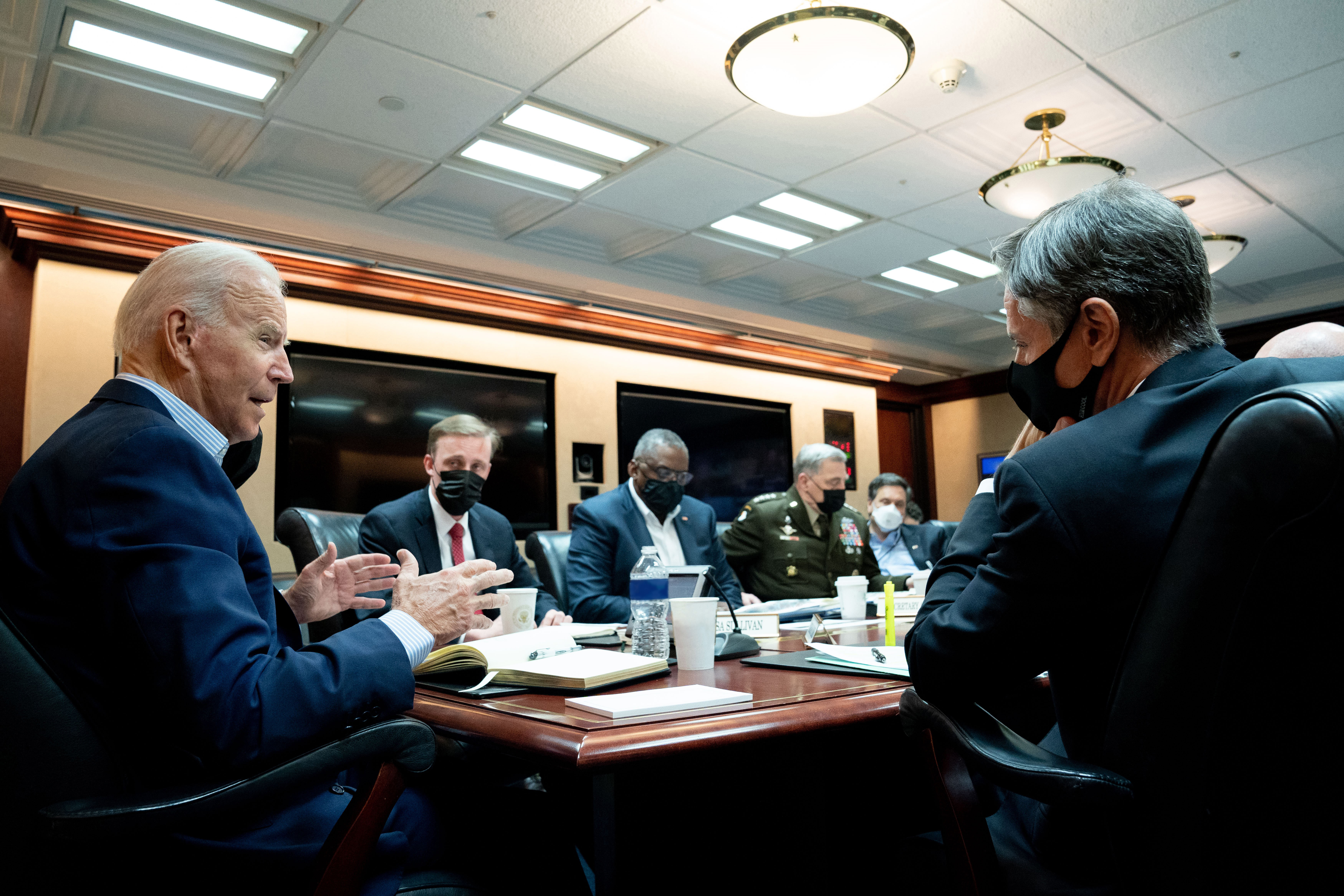 In this handout photo provided by the White House, Joe Biden meets with his national security team for an operational update on the situation in Afghanistan at the White House in Washington, D.C. (Photo by The White House via Getty Images)