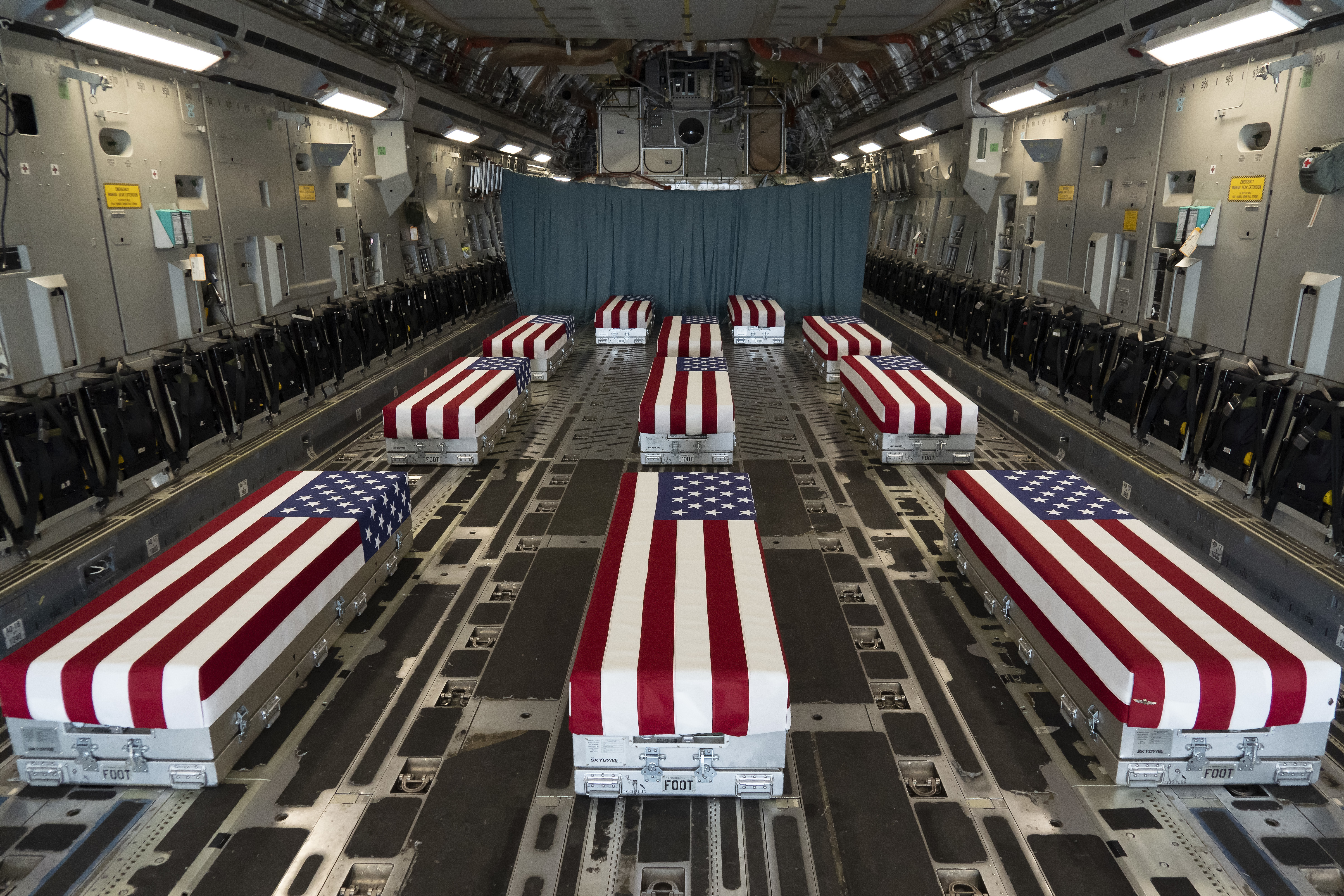 In this handout photo provided by the U.S. Air Force, flag-draped transfer cases line the inside of a C-17 Globemaster II prior to a dignified transfer at Dover Air Force Base, Delaware. (Photo by Jason Minto/U.S. Air Force via Getty Images)
