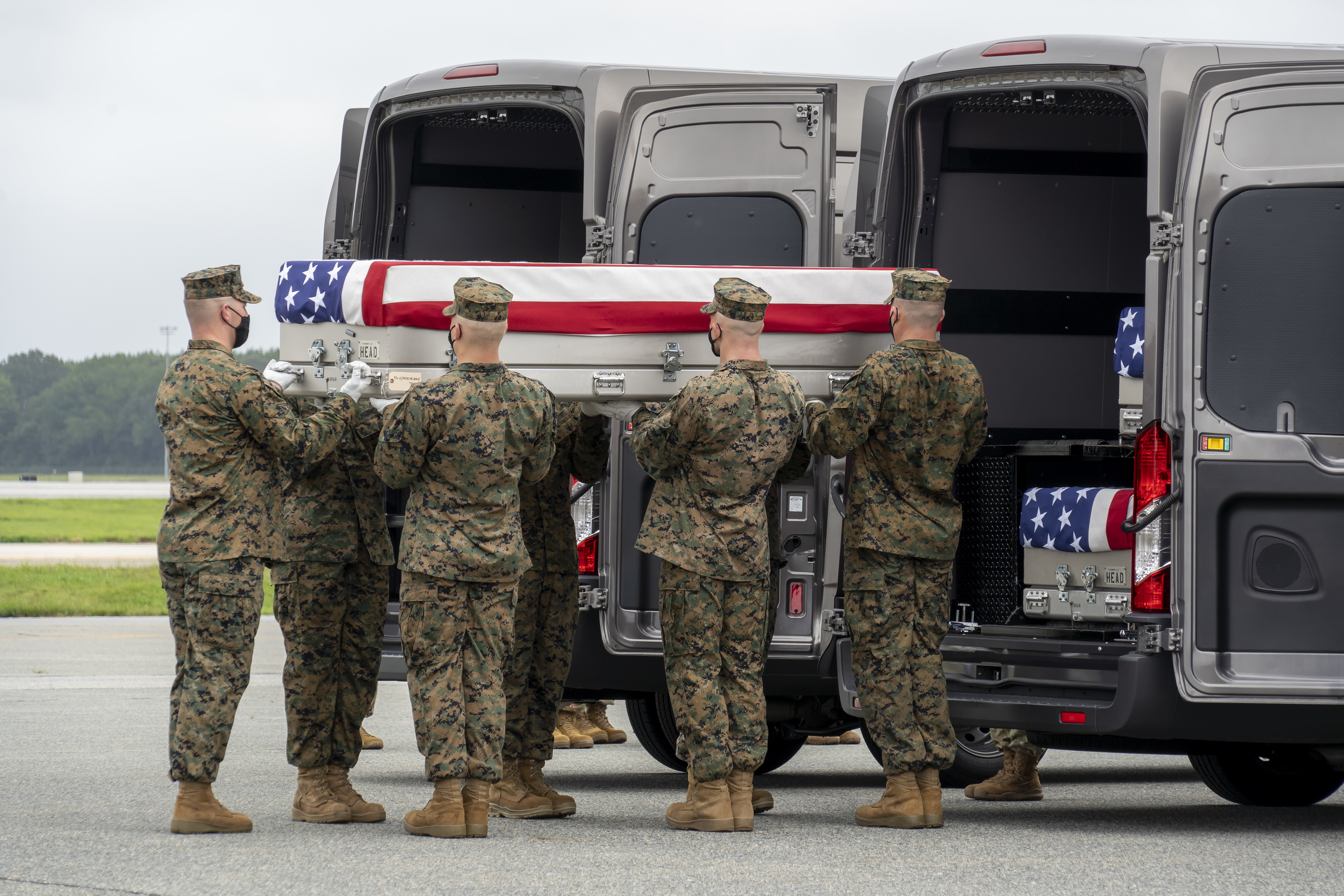 In this handout photo provided by the U.S. Air Force, a U.S. Marine Corps carry team transfers the remains of Marine Corps Lance Cpl. Kareem M. Nikoui of Norco, California, Aug. 29, 2021 at Dover Air Force Base, Delaware. Nikoui was assigned to 2nd Battalion, 1st Marine Regiment, 1st Marine Division, I Marine Expeditionary Force, Camp Pendleton, California. (Photo by Jason Minto/U.S. Air Force via Getty Images)