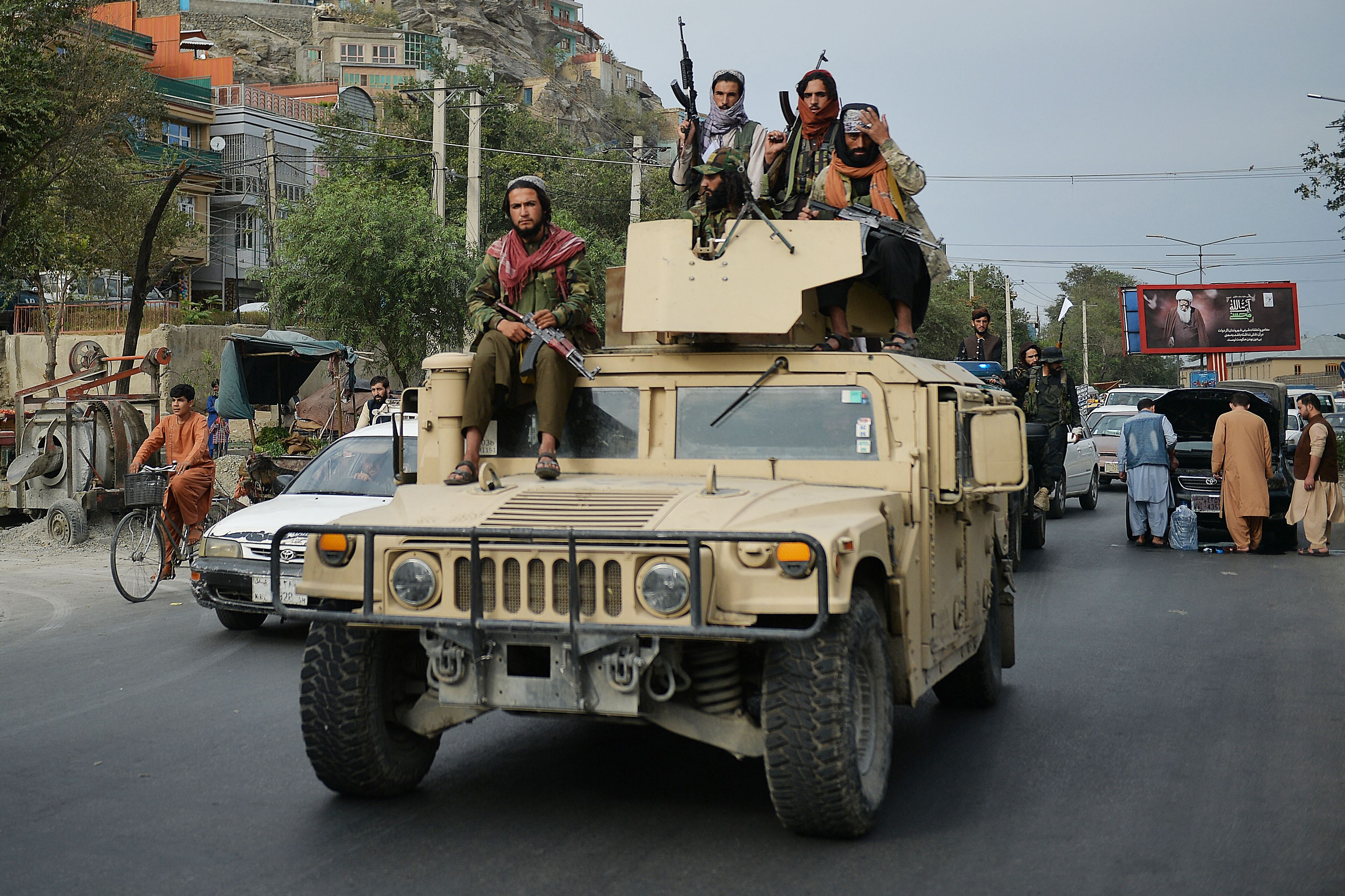 Taliban fighters atop a Humvee vehicle take part in a rally in Kabul  as they celebrate after the US pulled all its troops out of the country. (Photo by HOSHANG HASHIMI/AFP via Getty Images)
