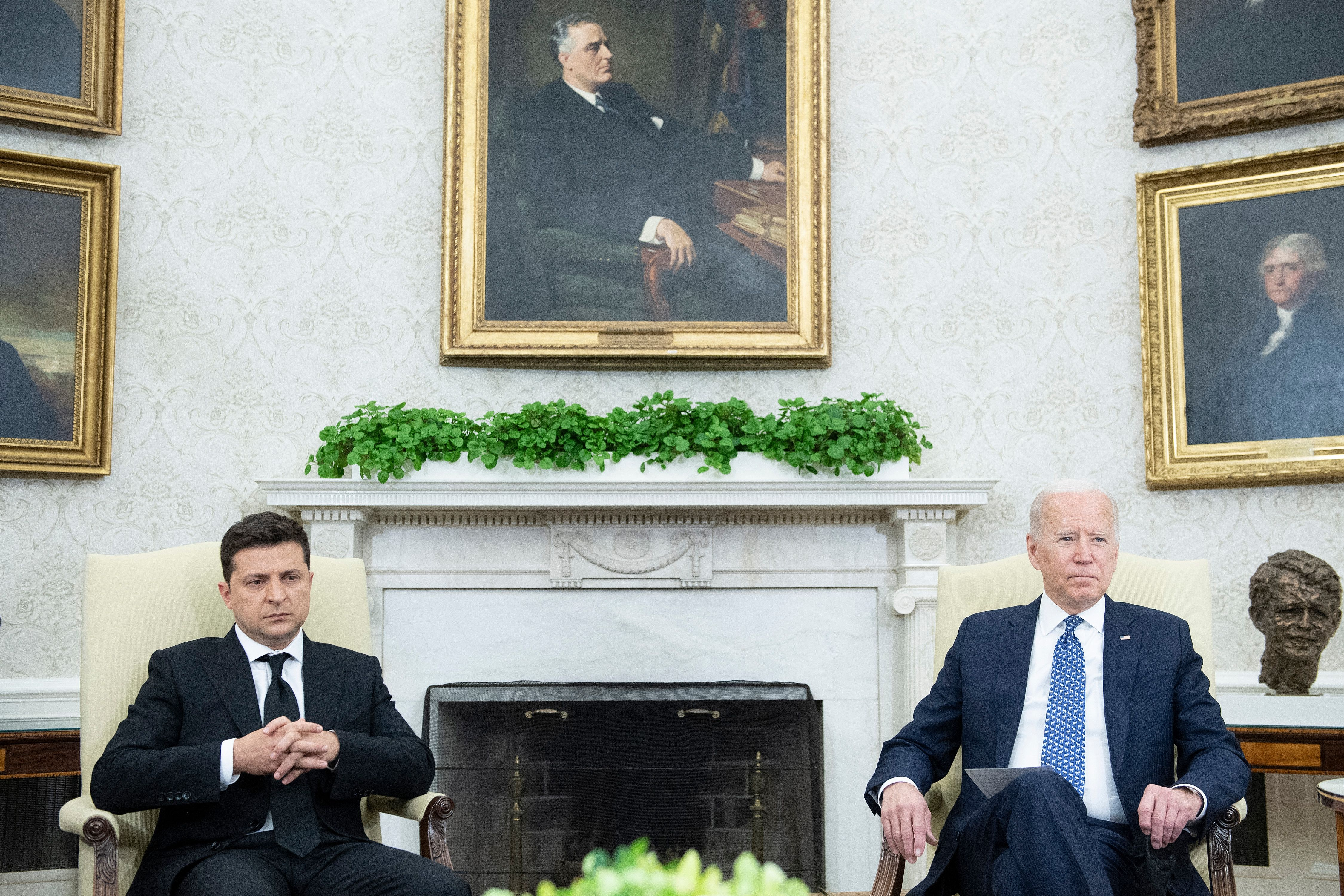 Joe Biden and Ukraine's President Volodymyr Zelensky before a meeting in the Oval Office of the White House in Washington, D.C. (Photo by BRENDAN SMIALOWSKI/AFP via Getty Images)