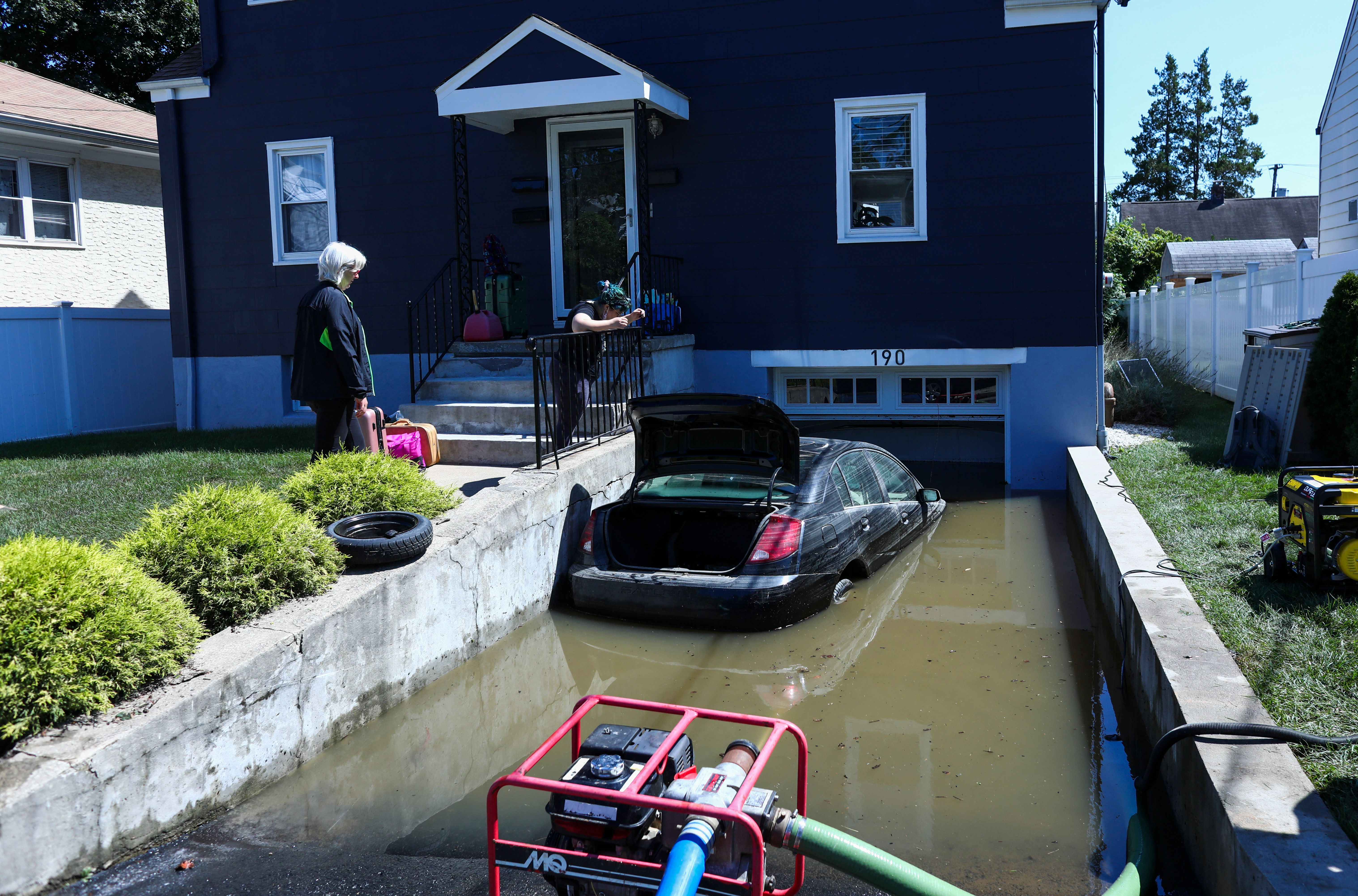 A car sits on a flooded garage of a house following a night of heavy wind and rain from the remnants of Hurricane Ida in Mamaroneck, New York. (Photo by KENA BETANCUR/AFP via Getty Images)