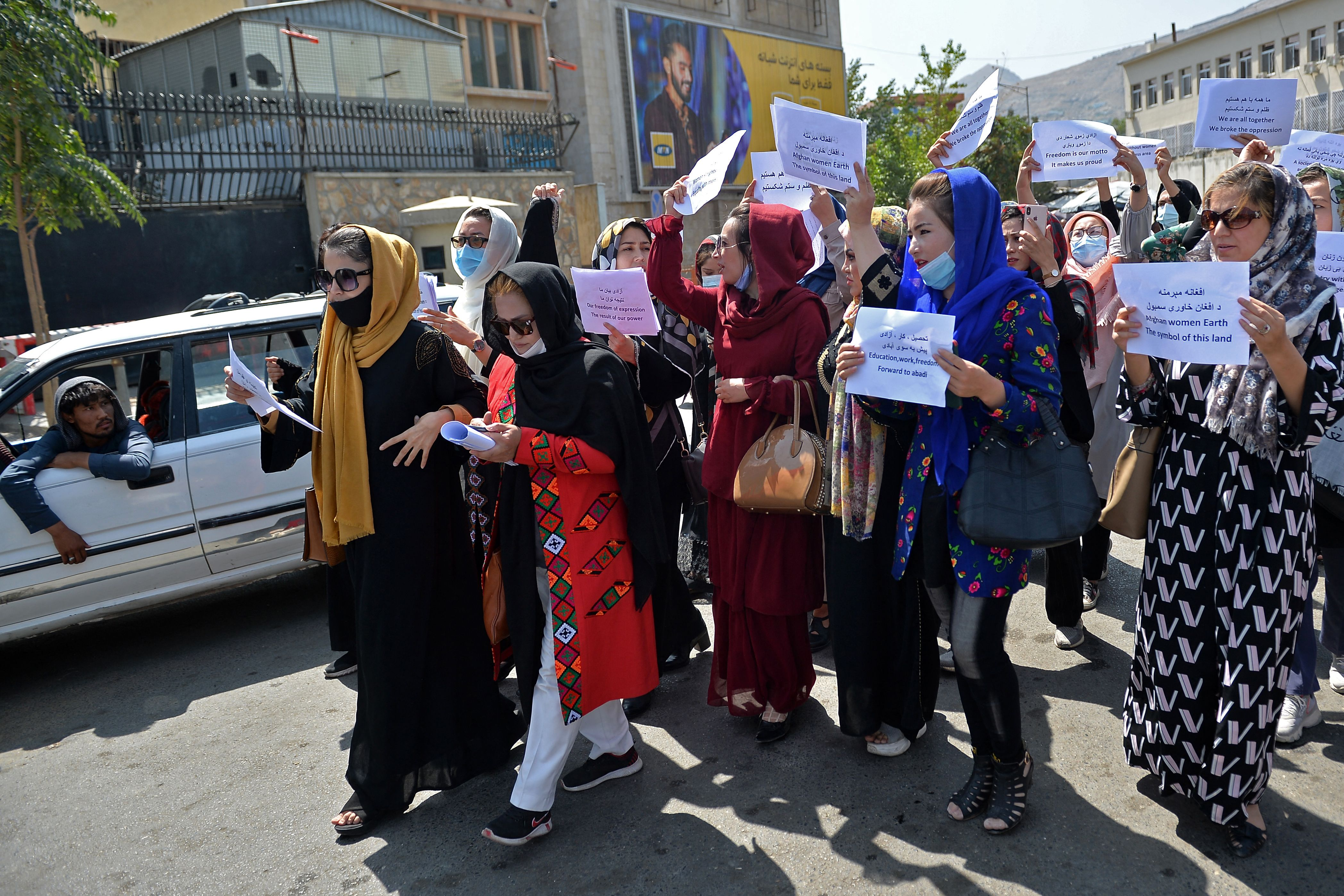 Afghan women take part in a protest march for their rights under the Taliban rule in the downtown area of Kabul. (Photo by HOSHANG HASHIMI/AFP via Getty Images)