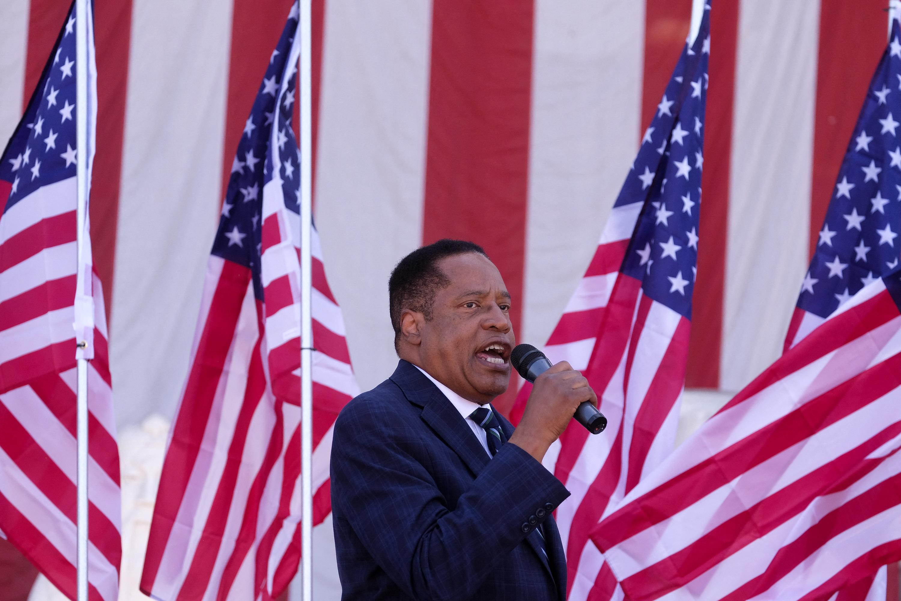 Republican gubernatorial candidate Larry Elder speaks to supporters during an Asian Rally for Yes Recall at the Asian Garden Mall in Little Saigon, Westminster, California. (Photo by RINGO CHIU/AFP via Getty Images)