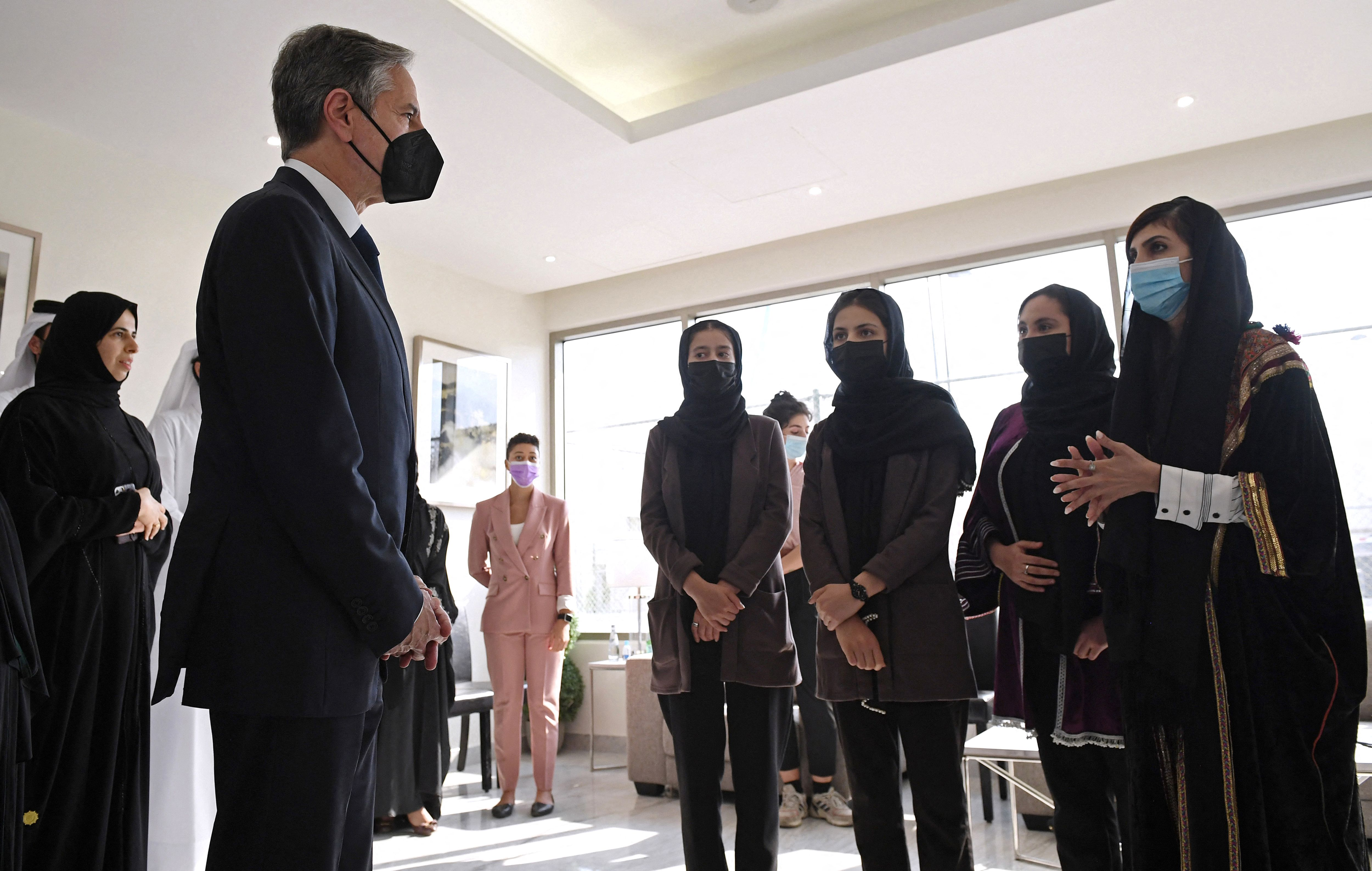 U.S. Secretary of State Antony Blinken meets with Afghan all-female robotics team members at Qatar's Education City Club House in Doha. (Photo by OLIVIER DOULIERY/POOL/AFP via Getty Images)