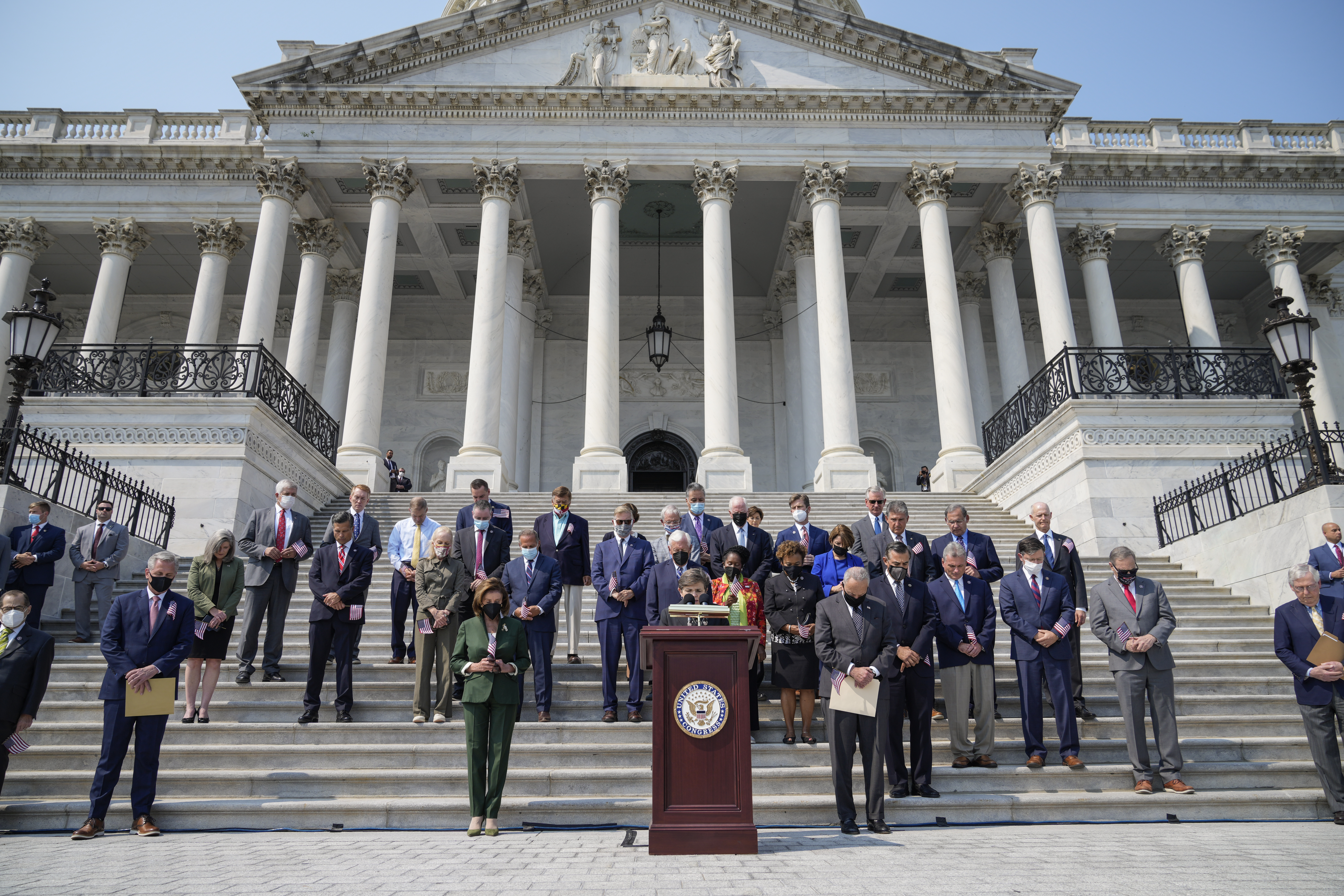 Members of Congress attend a remembrance ceremony marking the 20th anniversary of the 9/11 terror attacks on the steps of the U.S. Capitol, on September 13, 2021 in Washington, D.C. (Photo by Drew Angerer/Getty Images)