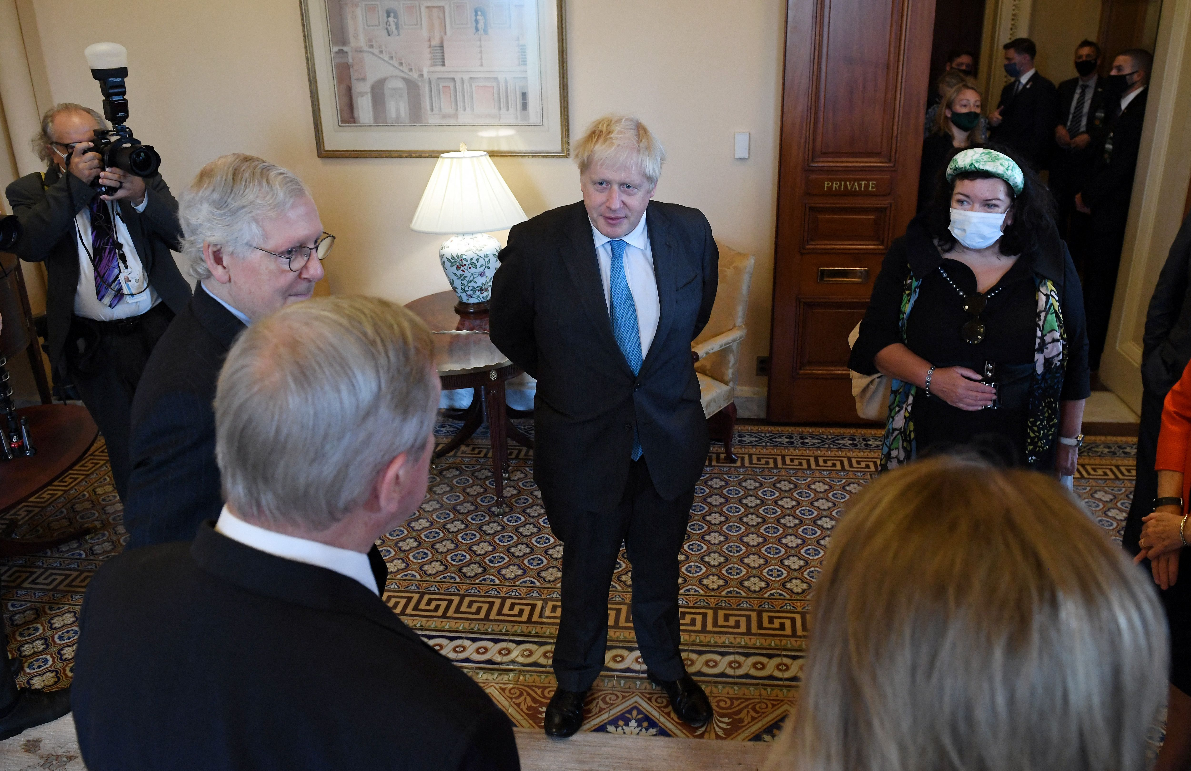 British Prime Minister Boris Johnson (center) meets with Senators including Senate Minority Leader Mitch McConnell (R-Ky.) (left) during a visit to the US Capitol on September 22, 2021 in Washington, D.C. (Photo by OLIVIER DOULIERY/AFP via Getty Images)