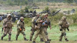 Ukrainian servicemen take part in the joint Rapid Trident military exercises with the United States and other NATO countries nor far from Lviv on September 24, 2021, as tensions with Russia remain high over the Kremlin-backed insurgency in the country's east. - The annual Rapid Trident military exercises, taking place in western Ukrainian until October 1, involve some 6,000 soldiers from 15 countries, Ukraine's defence ministry said in a statement. (Photo by Yuriy DYACHYSHYN / AFP) (Photo by YURIY DYACHYSHYN/AFP via Getty Images)