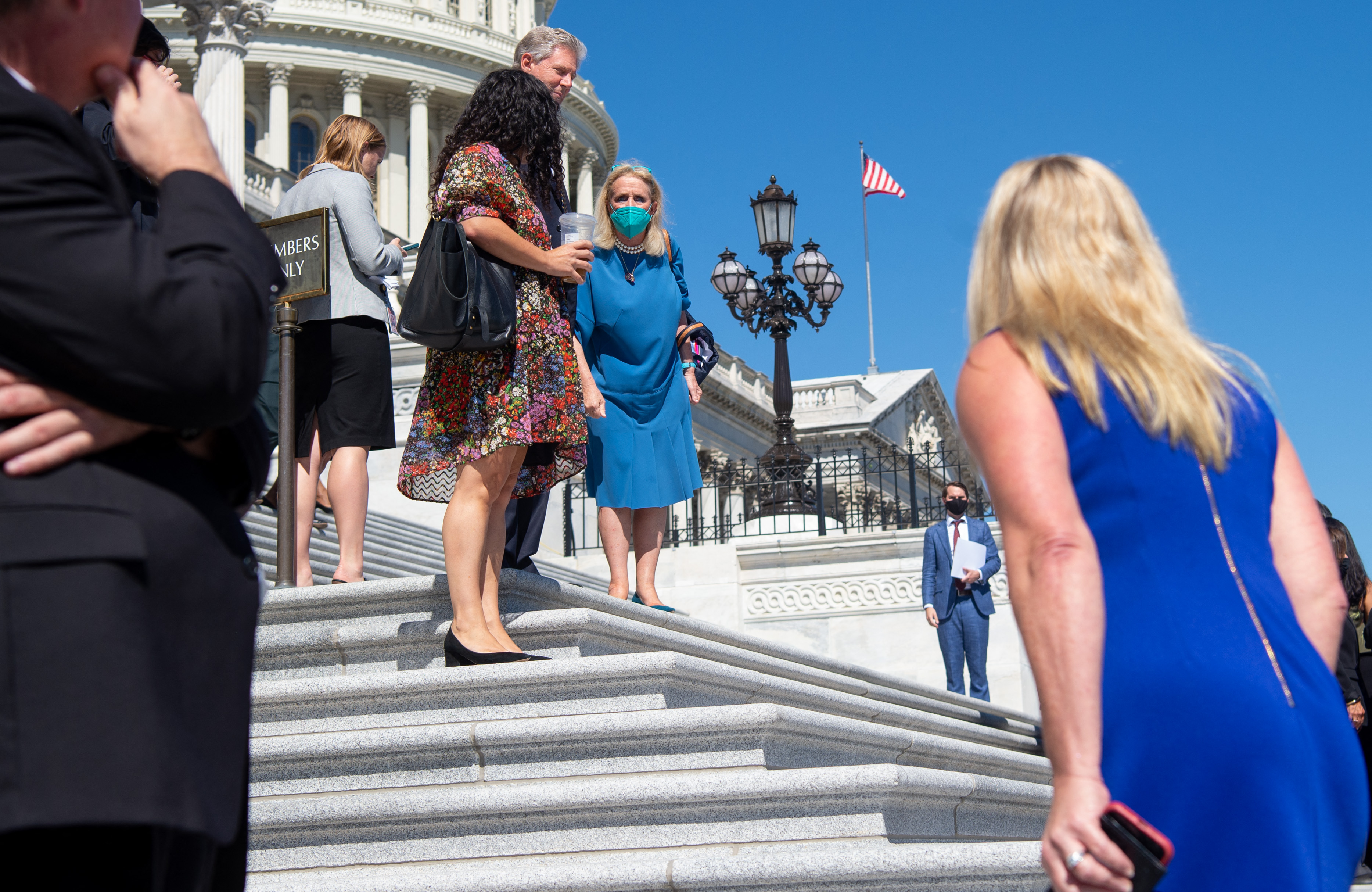 Rep. Debbie Dingell (center), Democrat of Michigan, shouts at Rep. Marjorie Taylor Greene (right), on the steps of the U.S. Capitol in Washington, D.C., September 24, 2021. (Photo by SAUL LOEB/AFP via Getty Images)