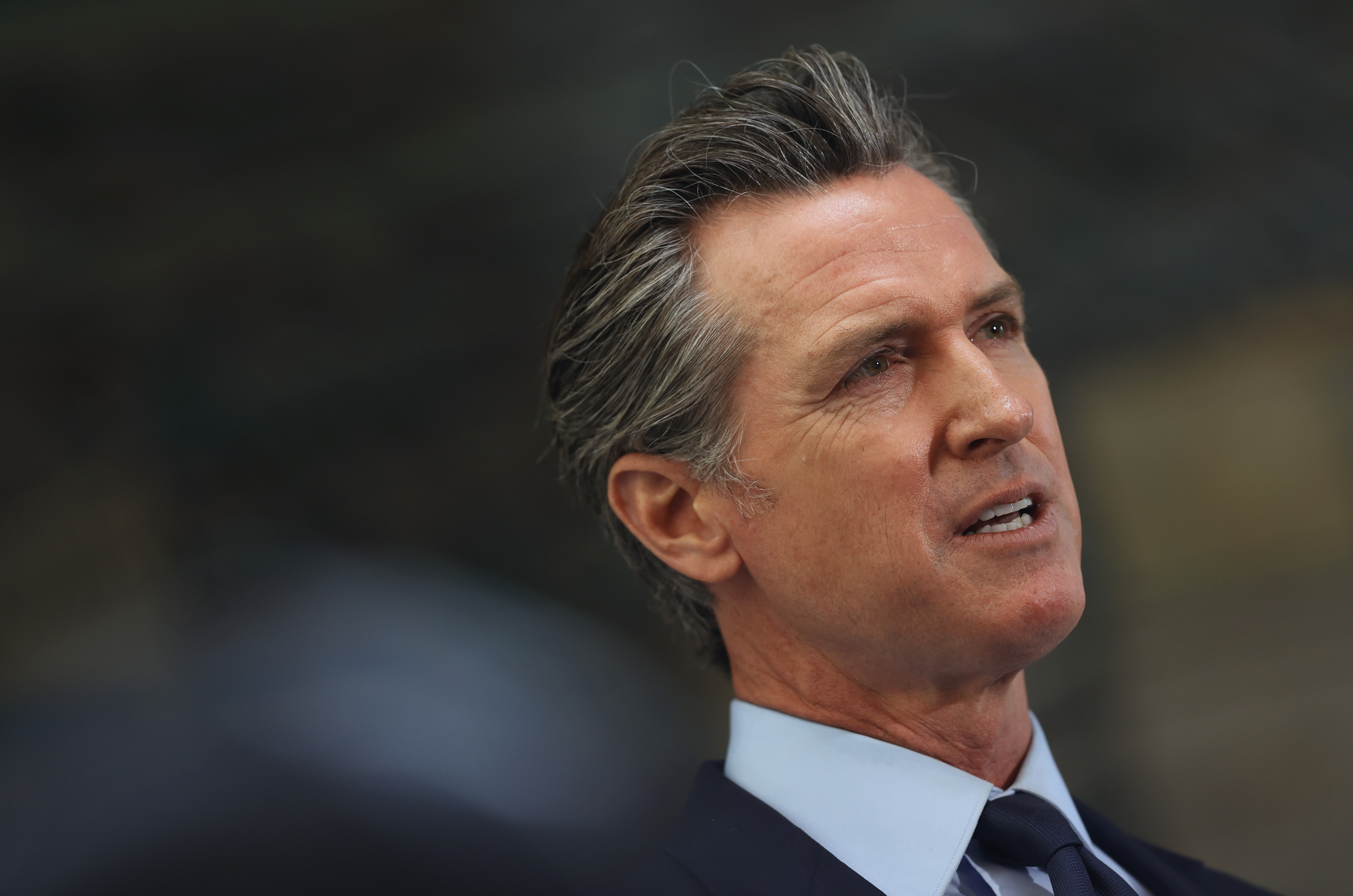 California Gov. Gavin Newsom looks on during a press conference at The Unity Council in Oakland, California. (Photo by Justin Sullivan/Getty Images)