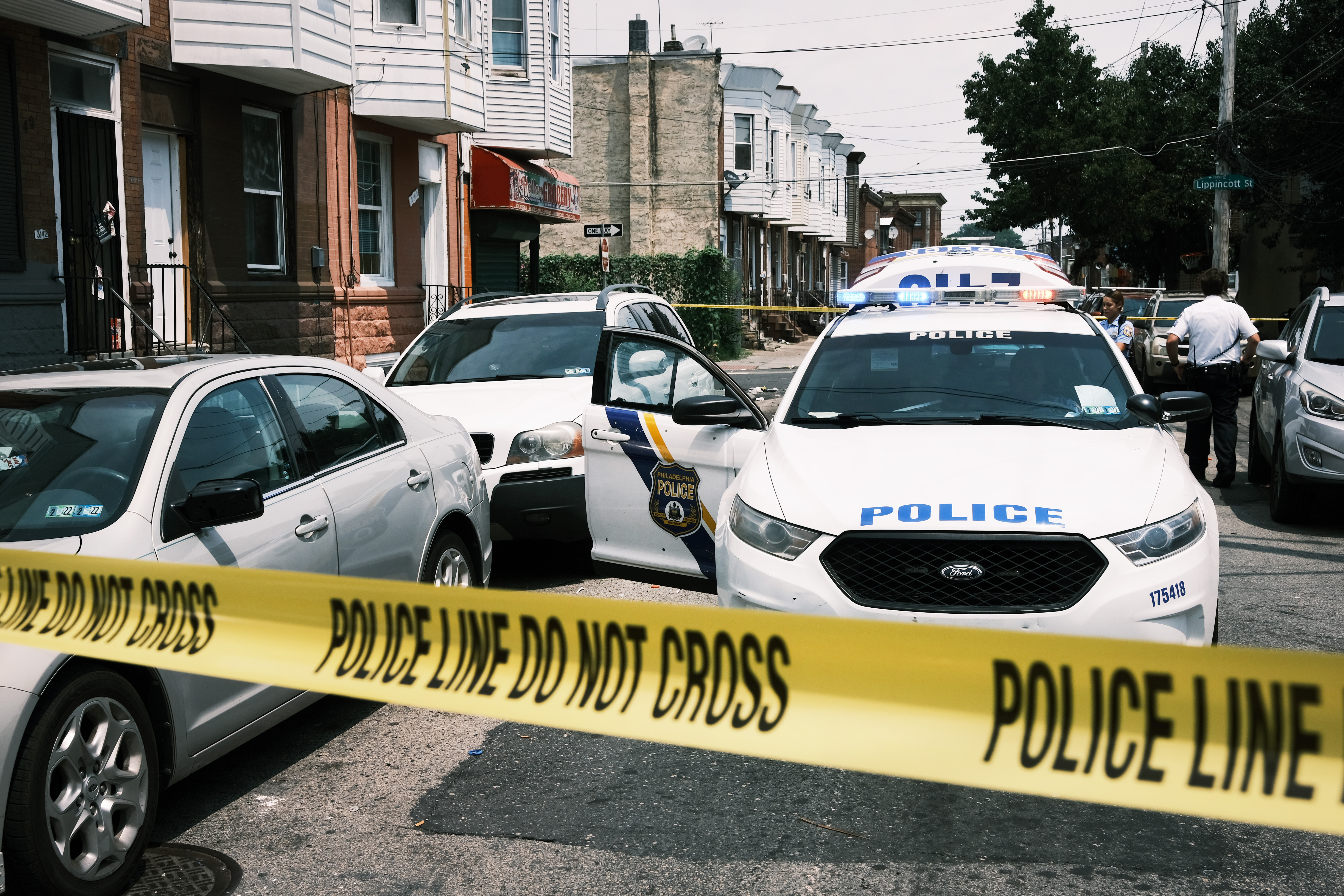 Police tape blocks a street where a person was recently shot in a drug related event in Kensington in Philadelphia, Pennsylvania. (Photo by Spencer Platt/Getty Images)
