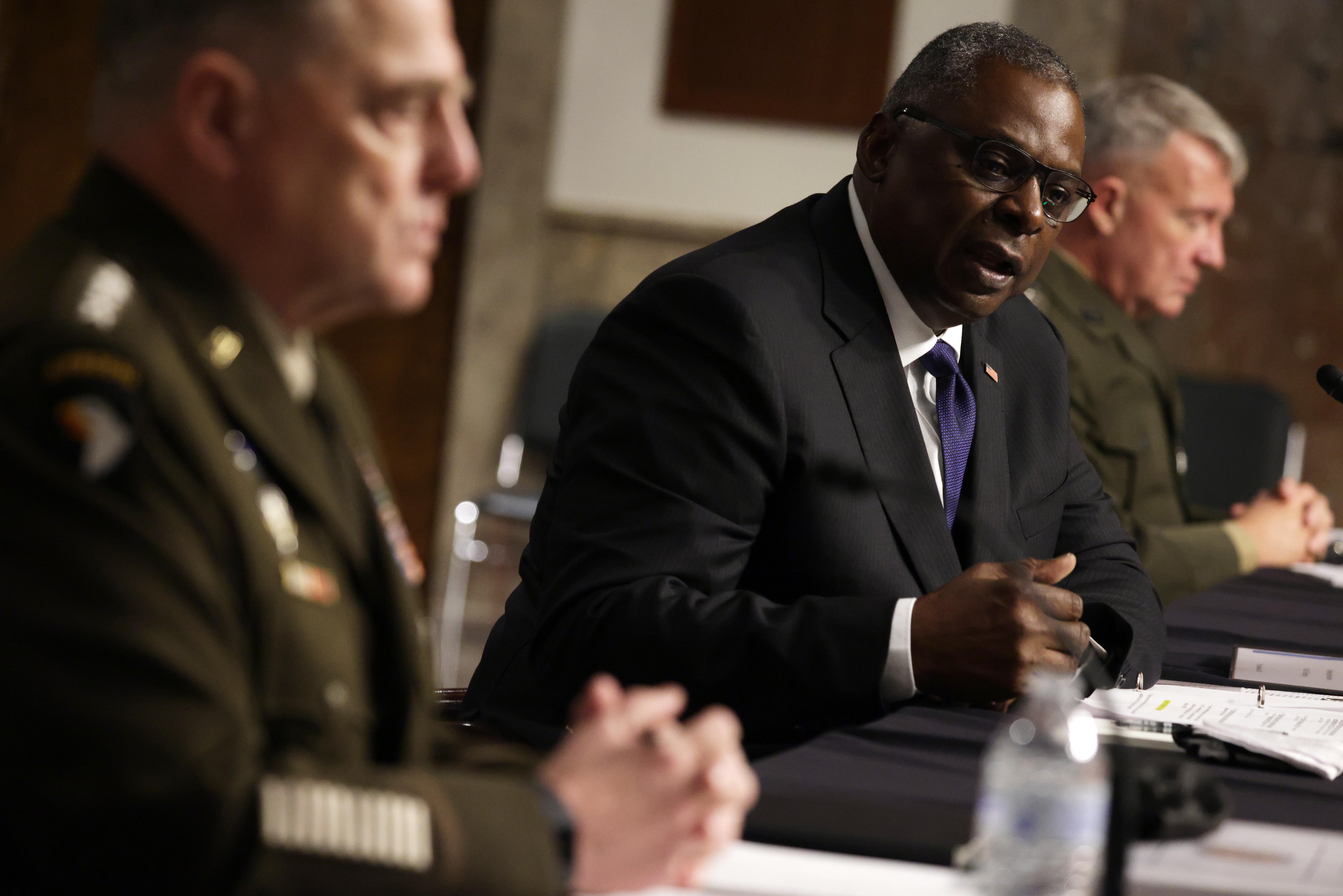 U.S. Secretary of Defense Lloyd Austin (center), Chairman of the Joint Chiefs of Staff Gen. Mark Milley (left) and Commander of U.S. Central Command Gen. Kenneth McKenzie (right) testify during a hearing before Senate Armed Services Committee at Dirksen Senate Office Building September 28, 2021 on Capitol Hill in Washington, DC. (Photo by Alex Wong/Getty Images)