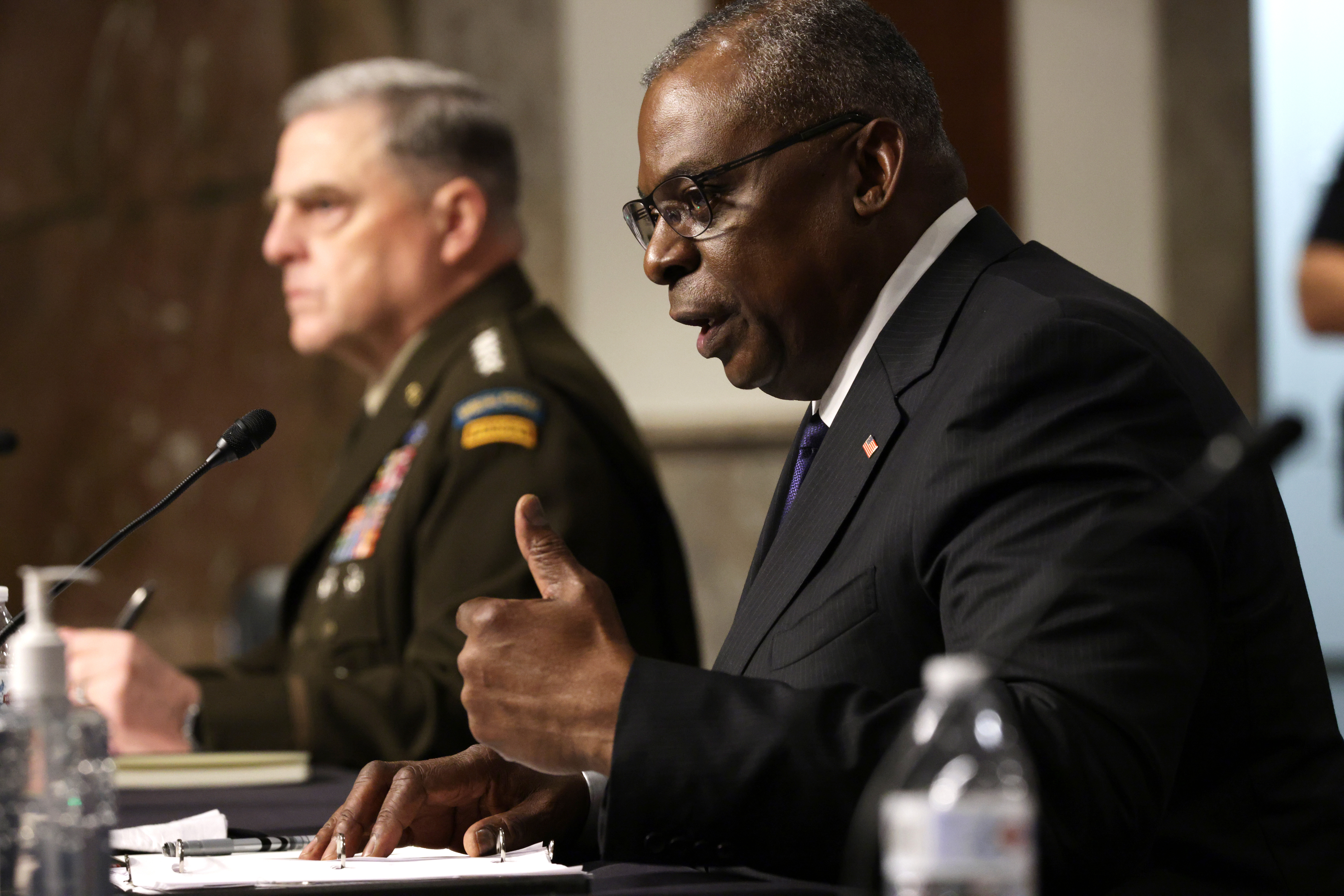 U.S. Secretary of Defense Lloyd Austin (right) and Chairman of the Joint Chiefs of Staff Gen. Mark Milley testify during a hearing before Senate Armed Services Committee at Dirksen Senate Office Building September 28, 2021 on Capitol Hill in Washington, DC. (Photo by Alex Wong/Getty Images)