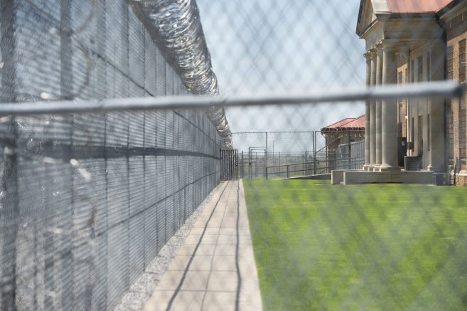 Fences and barbed wire at the entrance of the El Reno Federal Correctional Institution in El Reno, Oklahoma. (SAUL LOEB/AFP via Getty Images)