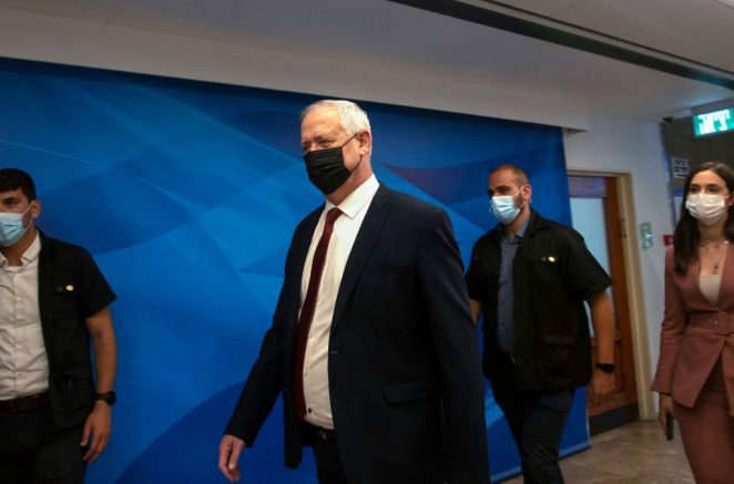 Israeli Defence Minister Benny Gantz arrives to attend the weekly cabinet meeting in Jerusalem, on June 27, 2021. - The Israeli health ministry reimposed a requirement on June 25 for masks to be worn in enclosed public places, following a surge in Covid-19 cases since the rule was dropped 10 days earlier. (Photo by Maya Alleruzzo / POOL / AFP) (Photo by MAYA ALLERUZZO/POOL/AFP via Getty Images)