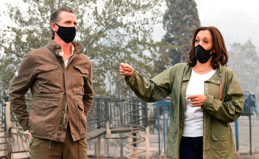 US Democratic vice presidential nominee and Senator from California, Kamala Harris speaks next to with California Governor Gavin Newsom as they visit Pine Ridge Elementary School where they met with firefighters and toured fire-ravaged properties damaged from the Creek Fire nearby in an unincorporated area of Fresno, California on September 15, 2020. (Photo by Frederic J. BROWN / AFP) (Photo by FREDERIC J. BROWN/AFP via Getty Images)