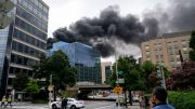 WASHINGTON, DC - SEPTEMBER 16: Smoke billows from a building fire downtown on September 16, 2021 in Washington, DC. Washington Metropolitan Area Transit Authority (Metro) confirmed the fire was atop their future headquarters building that is currently under construction. (Photo by Drew Angerer/Getty Images)