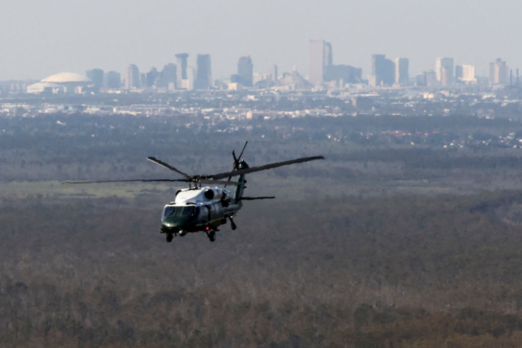 The skyline of New Orleans is seen in the background as US President Joe Biden onboard Marine One inspects the damage from Hurricane Ida on an aerial tour of communities in Louisiana, September 3, 2021. - President Joe Biden, who has made threats from climate change a priority, arrived in New Orleans to tour damage from Hurricane Ida, which pounded the Gulf Coast before bringing havoc to New York. (Photo by JONATHAN ERNST / POOL / AFP) (Photo by JONATHAN ERNST/POOL/AFP via Getty Images)