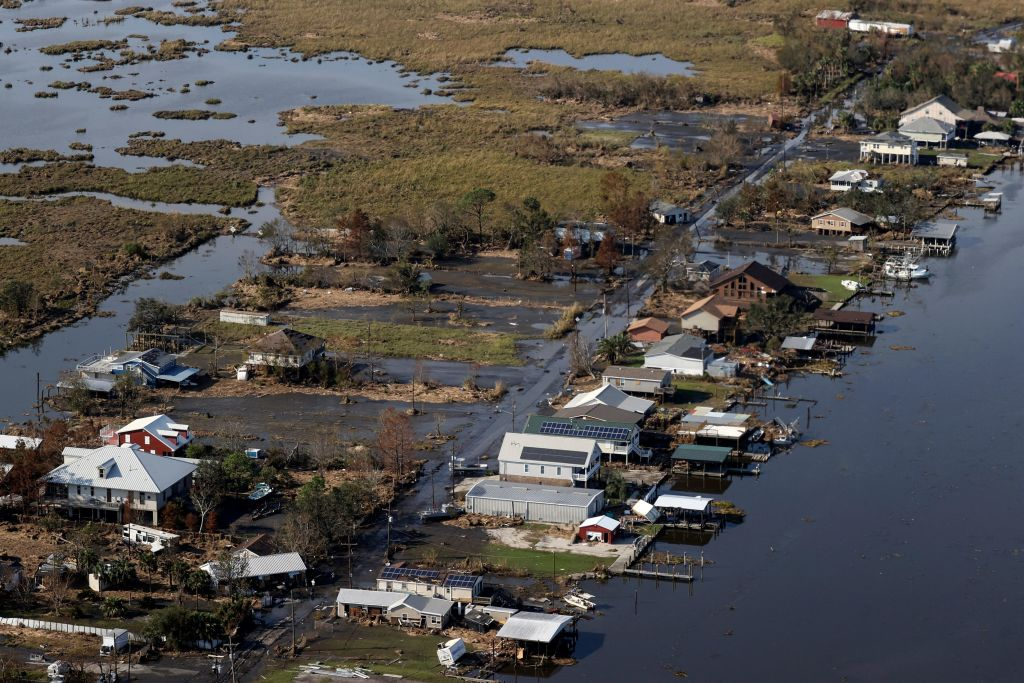 A view of flood damaged buildings are seen as US President Joe Biden (not pictured) inspects the damage from Hurricane Ida onboard Marine One during an aerial tour of communities in Laffite, Grand Isle, Port Fourchon and Lafourche Parish, Louisiana, September 3, 2021. - President Joe Biden, who has made threats from climate change a priority, arrived in New Orleans to tour damage from Hurricane Ida, which pounded the Gulf Coast before bringing havoc to New York. (Photo by JONATHAN ERNST / POOL / AFP) (Photo by JONATHAN ERNST/POOL/AFP via Getty Images)
